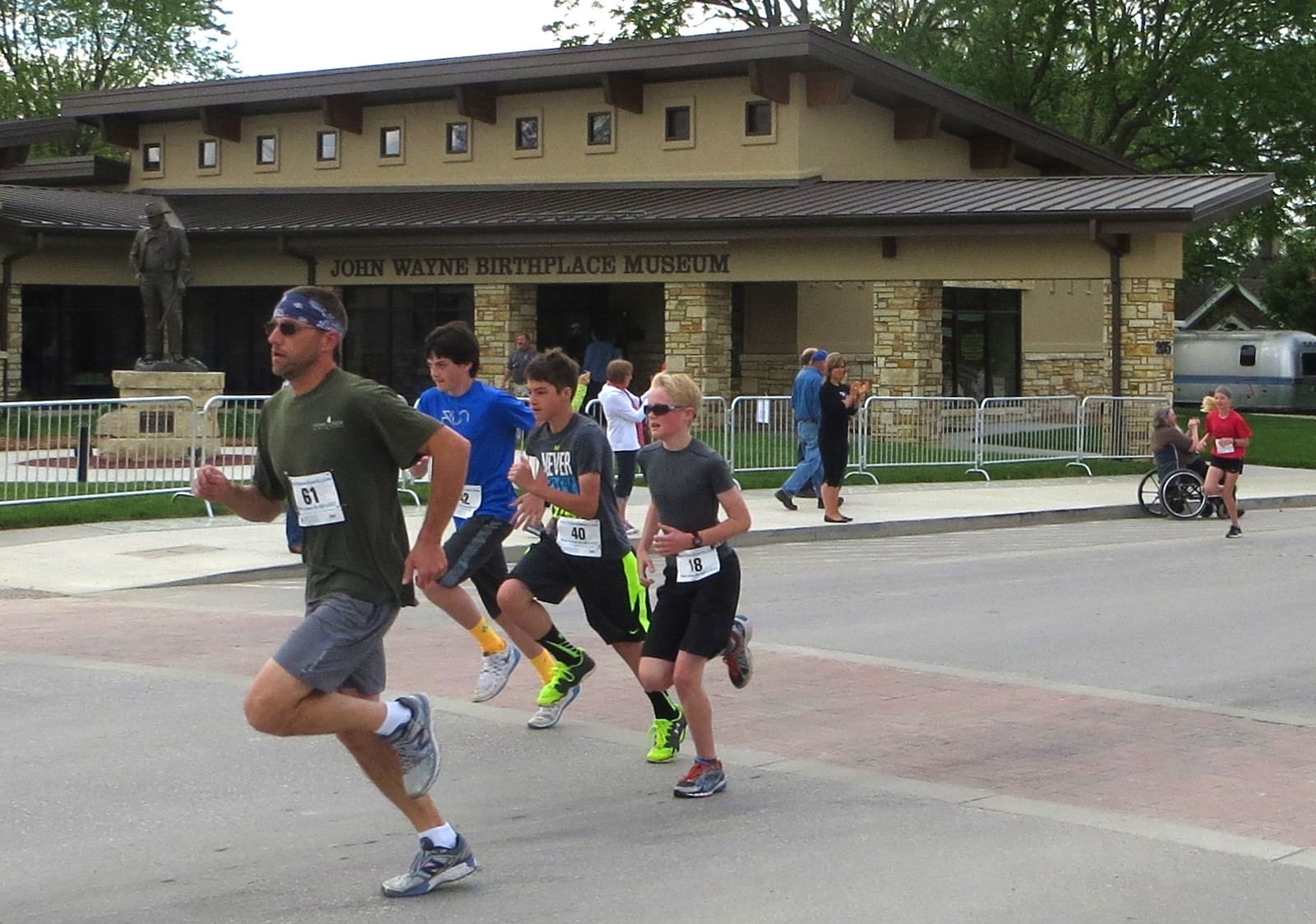 2015-05-23-John-Wayne-5K-runners-pass-the-Birthplace-Museum